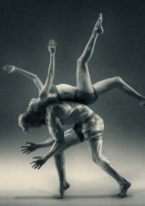 Woman Flipping Over A Man